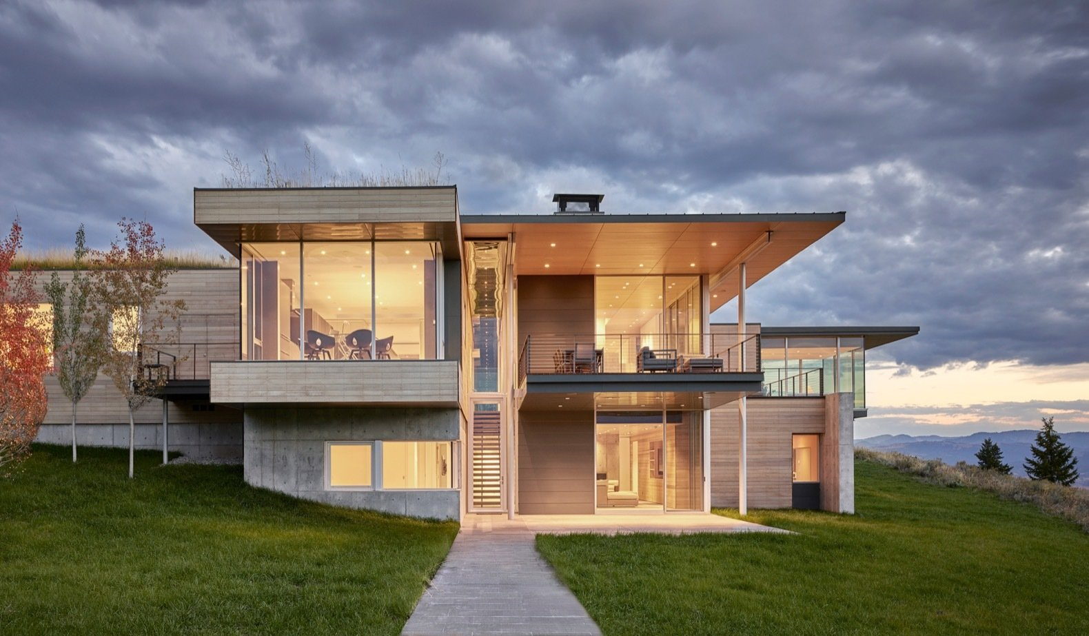 Exterior, Wood Siding Material, Metal Roof Material, House Building Type, Metal Siding Material, Flat RoofLine, Concrete Siding Material, and Green Roof Material The elegant retreat combines contemplative spaces with a sense of drama.   Photo 1 of 17 in A Modern House Accentuates a Sensational Wyoming Landscape