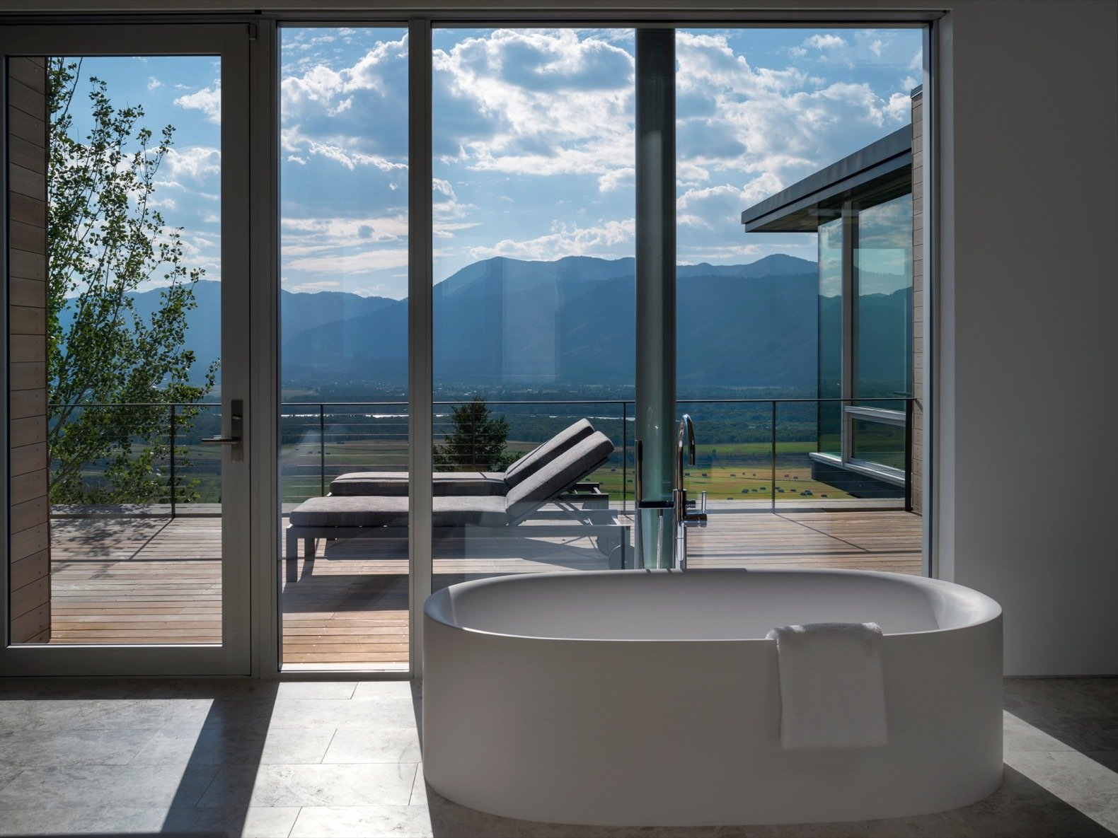Bath Room and Freestanding Tub A freestanding pub offers a soak with a view.  Photo 13 of 17 in A Modern House Accentuates a Sensational Wyoming Landscape