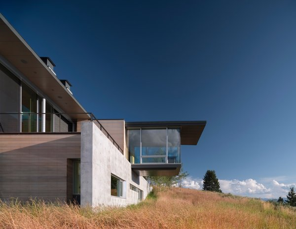 Exposed concrete walls provide thermal mass and protection from wildland fires.