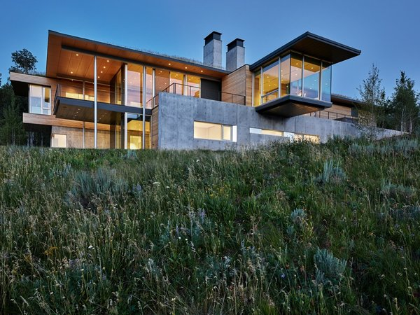 Since the home is located in a Class D Seismic Zone, the architects have designed the home beyond code-required structural standards with concrete foundations, steel columns, and composite decking.