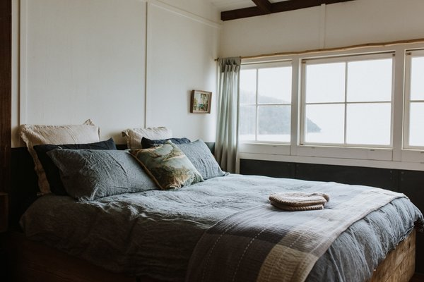 In the main bedroom, the couple have built the king-size bed frame out of recycled timber.