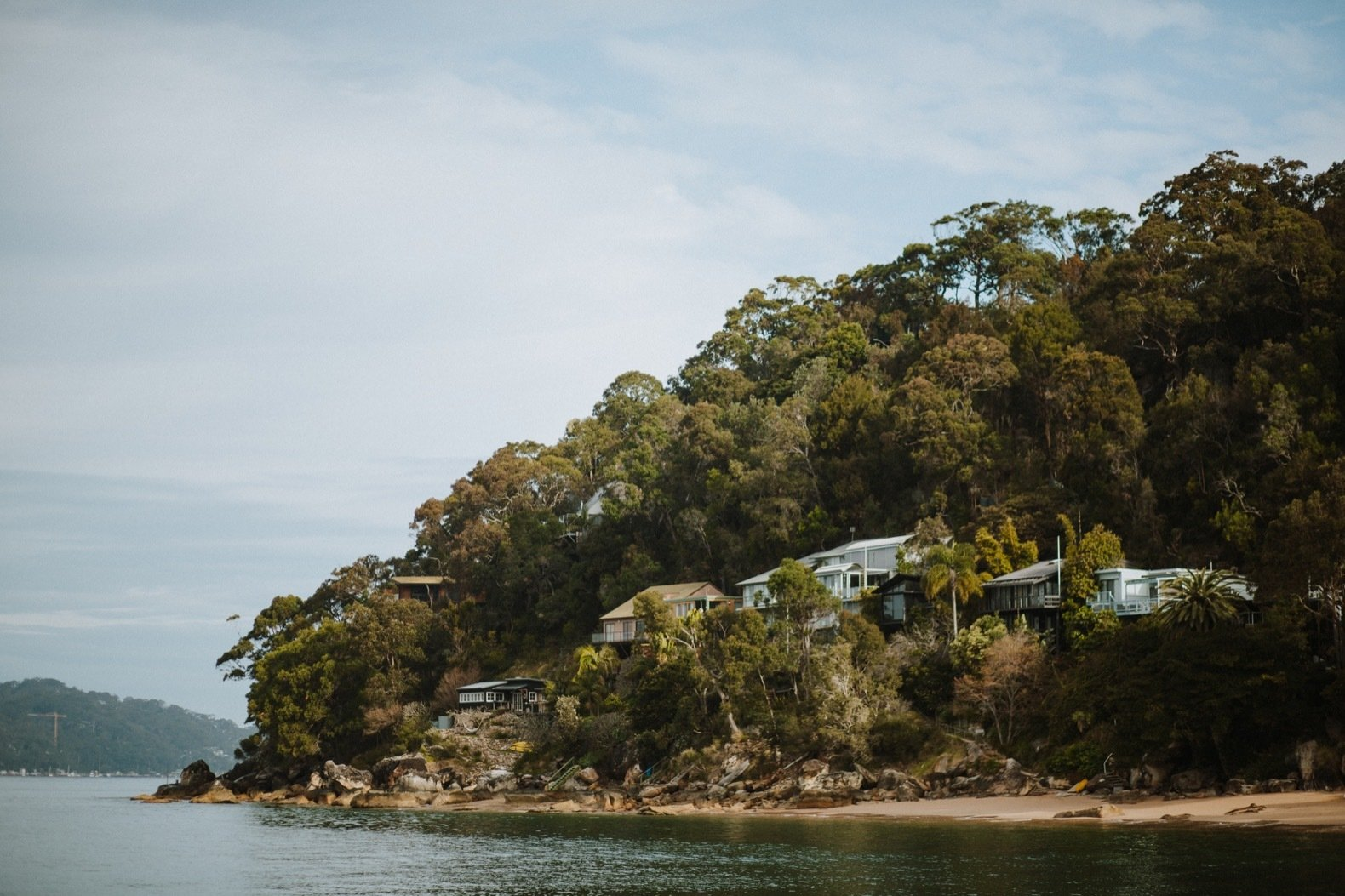 Outdoor, Trees, and Boulders The shack is only accessible via two ways: taking a boat across Pittwater Bay or hiking through the Ku-ring-gai Chase National Park.  Photo 2 of 11 in A 1920s Fisherman's Shack in Australia Breathes New Life as a Cozy, Unique Rental