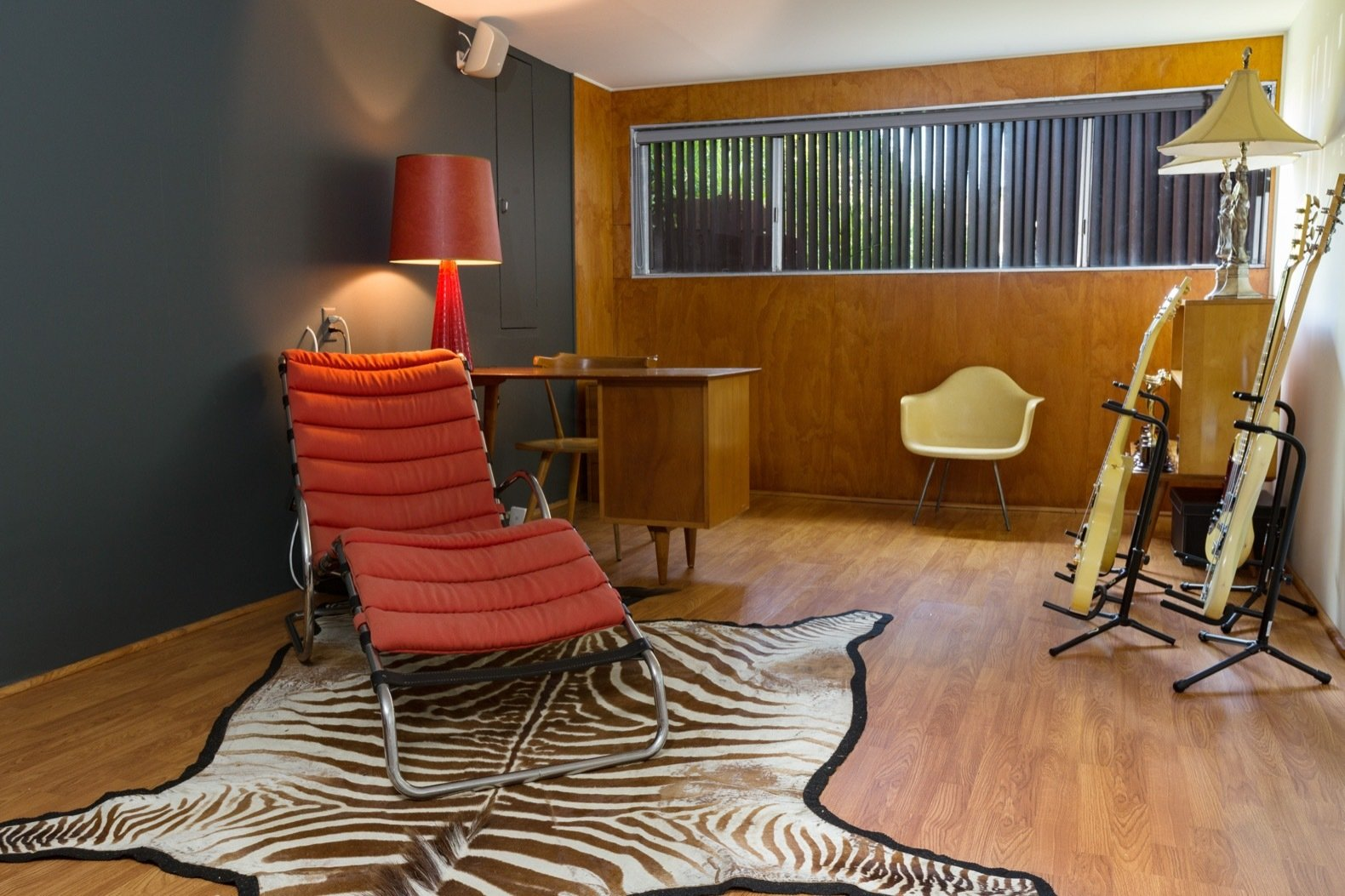 Office, Lamps, Study Room Type, Desk, Medium Hardwood Floor, Chair, and Rug Floor Hardwood floors line the studio.  Photo 13 of 15 in Calling All Richard Neutra Fans—His Bonnet House in L.A. Hits the Market at $1.8M