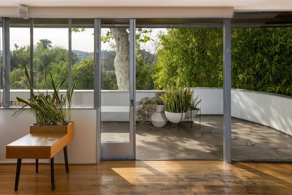 Sliding doors open the great room up to the outdoors.