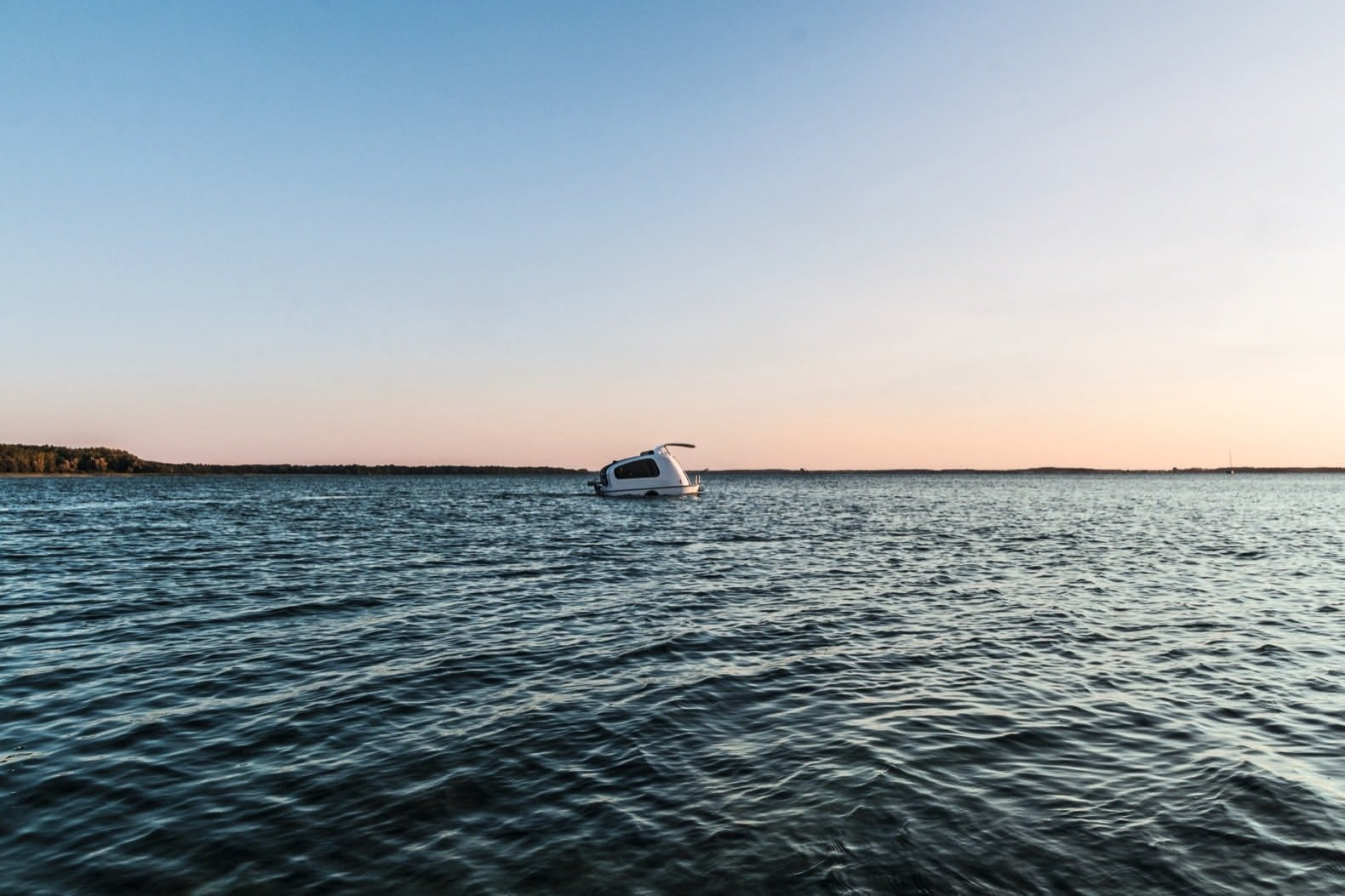 Exterior, Curved RoofLine, Camper Building Type, Metal Roof Material, and Metal Siding Material Developed by Daniel Straub, the Sealander combines the German entrepreneur's love of the outdoors with his background in industrial design.    Photo 1 of 8 in This Amphibious Tiny Camper Tackles Land and Sea For Just $20K