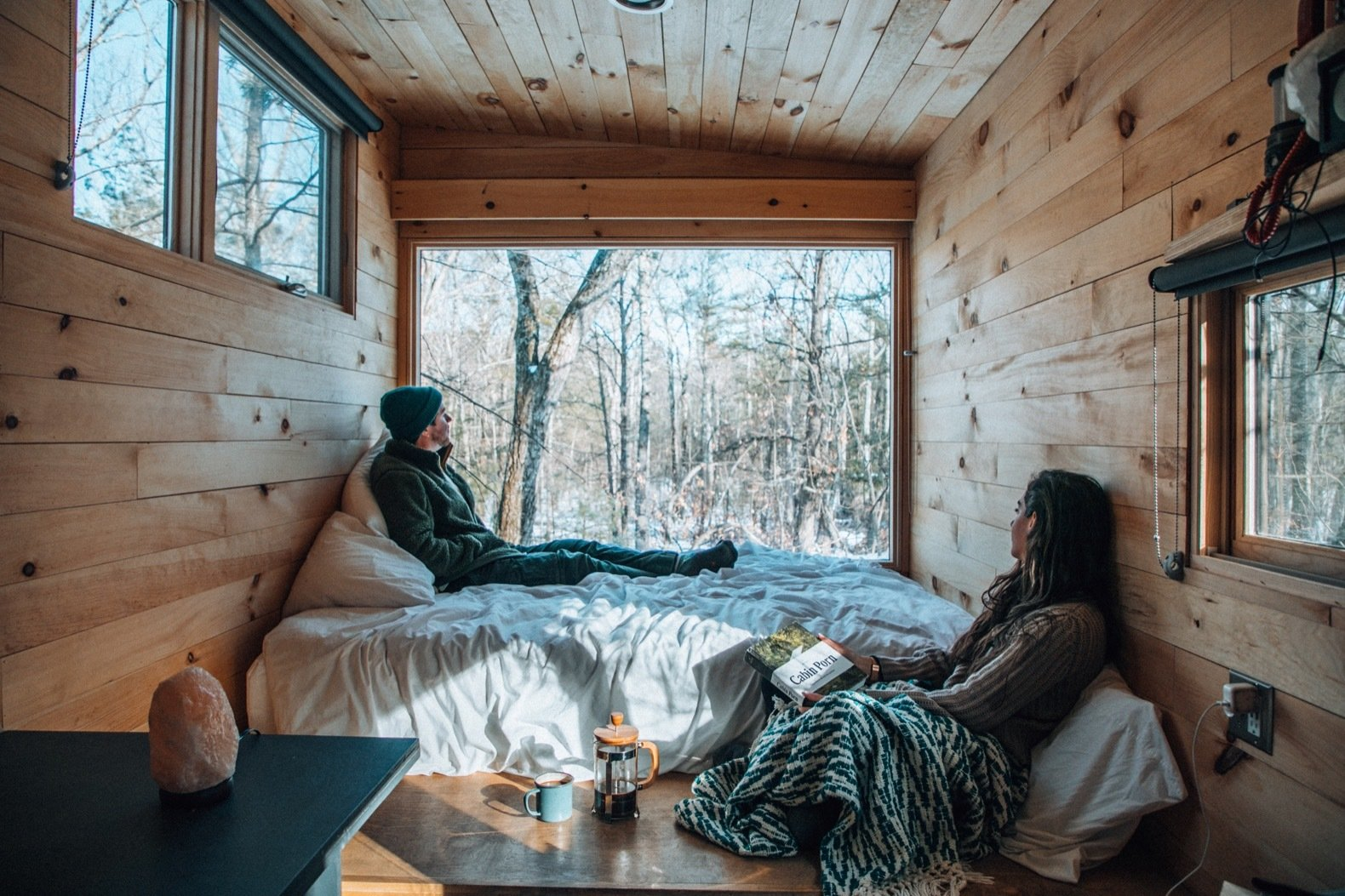 Bedroom, Bed, Ceiling Lighting, and Medium Hardwood Floor The tiny cabins range between 140 and 200 square feet in size.  Photo 8 of 9 in Rediscover the Pleasure of Solitude in These Micro Cabins Across the East Coast