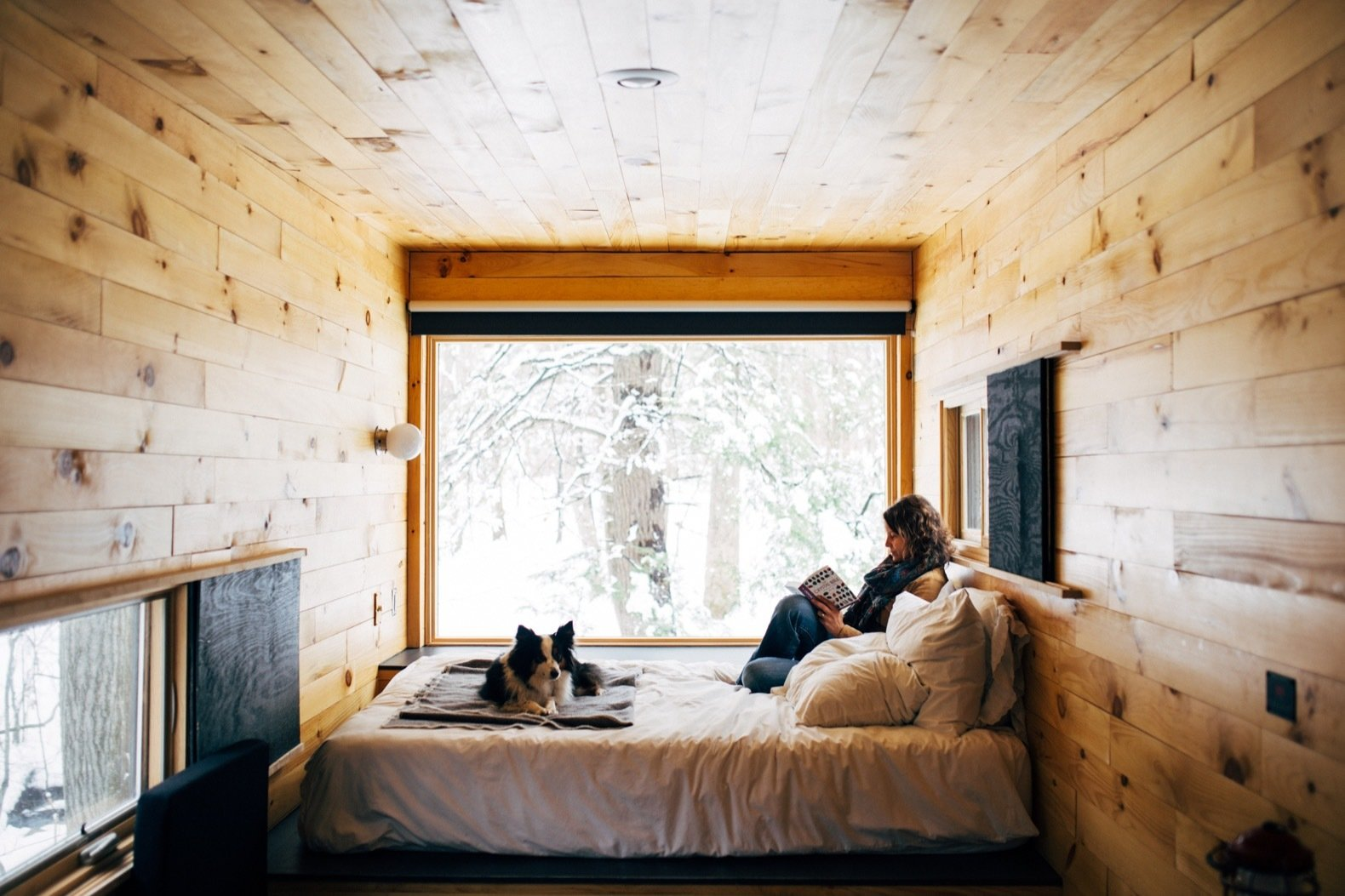 Bedroom, Wall Lighting, Medium Hardwood Floor, Ceiling Lighting, and Bed Getaway offers rentable micro cabins to help urban dwellers escape the daily grind.  Photo 6 of 9 in Rediscover the Pleasure of Solitude in These Micro Cabins Across the East Coast