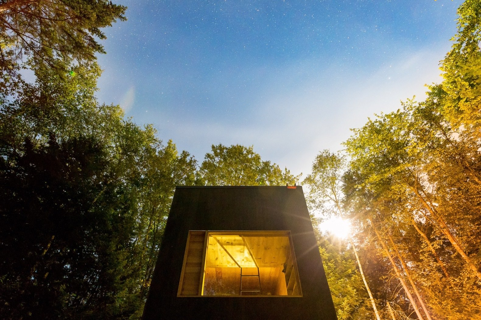 Exterior, Cabin Building Type, Wood Siding Material, and Flat RoofLine The timber exterior is stained to help the cabins blend in with the environment.   Photo 9 of 9 in Rediscover the Pleasure of Solitude in These Micro Cabins Across the East Coast