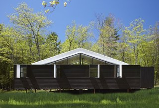 The three-bedroom home's gabled roof mimics the shape of a tent.