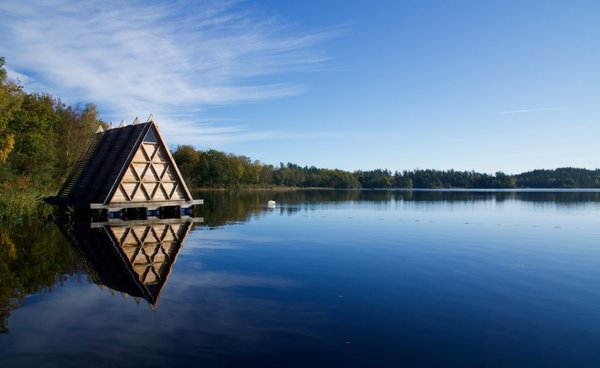 The floating sauna has an oak frame and is cladded in larch, materials chosen for their ability to withstand the elements without the use of any chemicals.