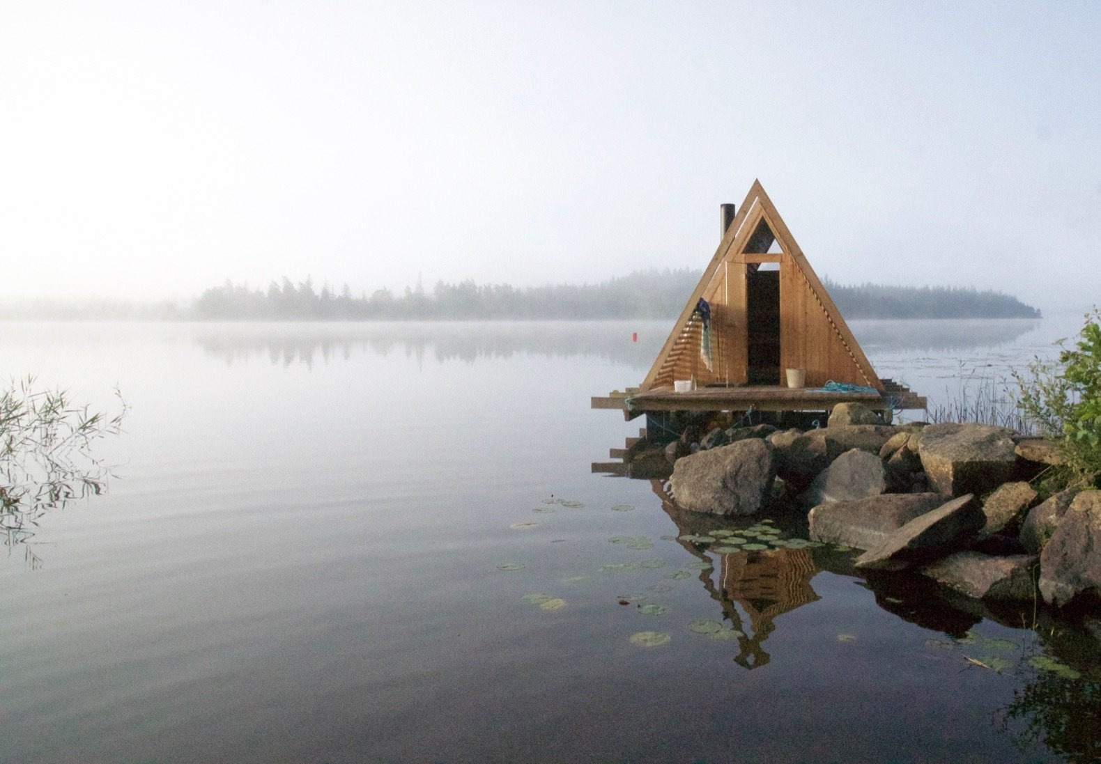 Exterior, A-Frame RoofLine, and Wood Siding Material The floating sauna was completed last fall.   Photo 15 of 18 in This Swedish Permaculture Retreat Is a Foodie's Paradise