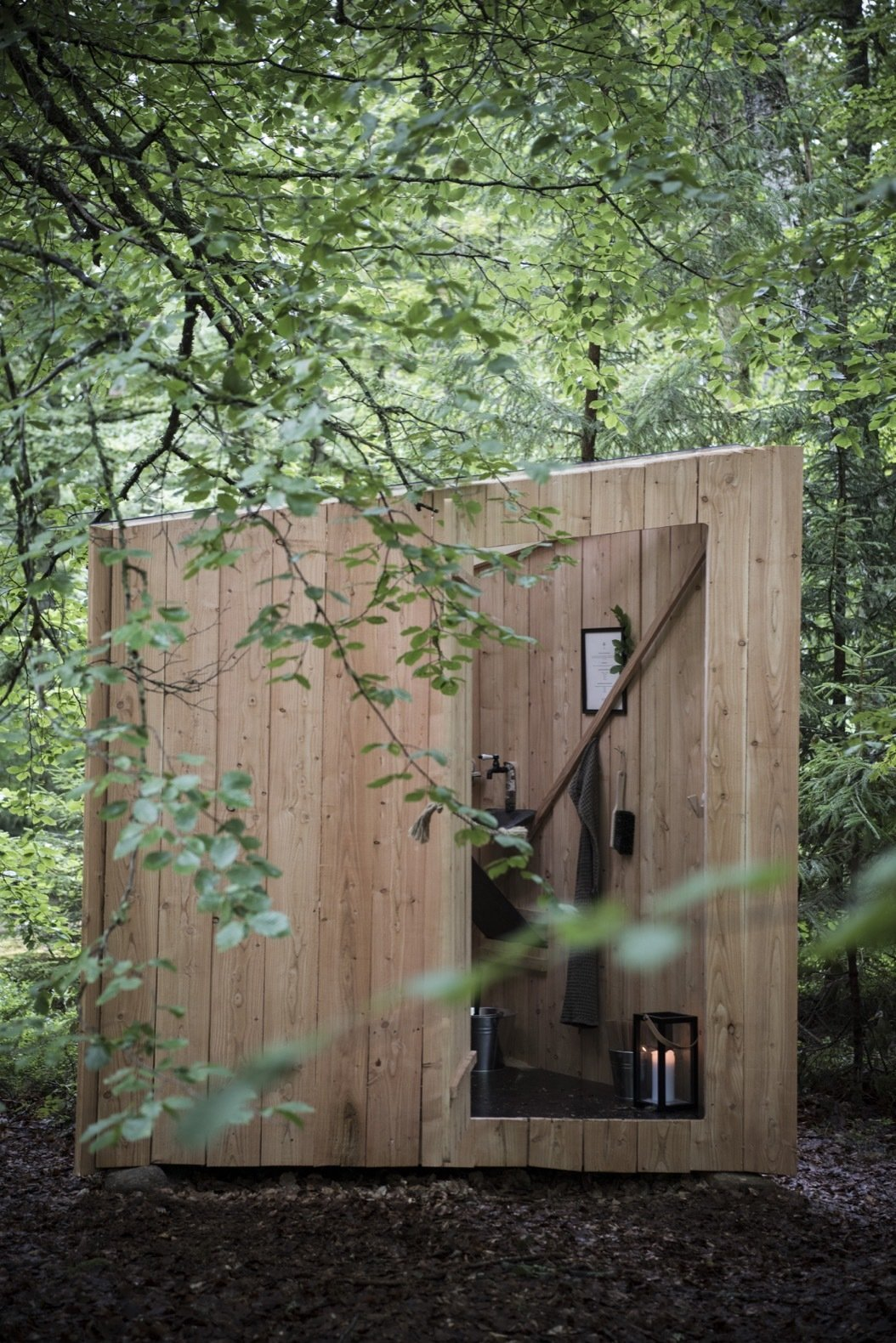 Exterior Composting toilets are housed in the outhouses designed and built by Flemming and Thorbjørn Flegal using larch, slate, and glass.    Photo 17 of 18 in This Swedish Permaculture Retreat Is a Foodie's Paradise