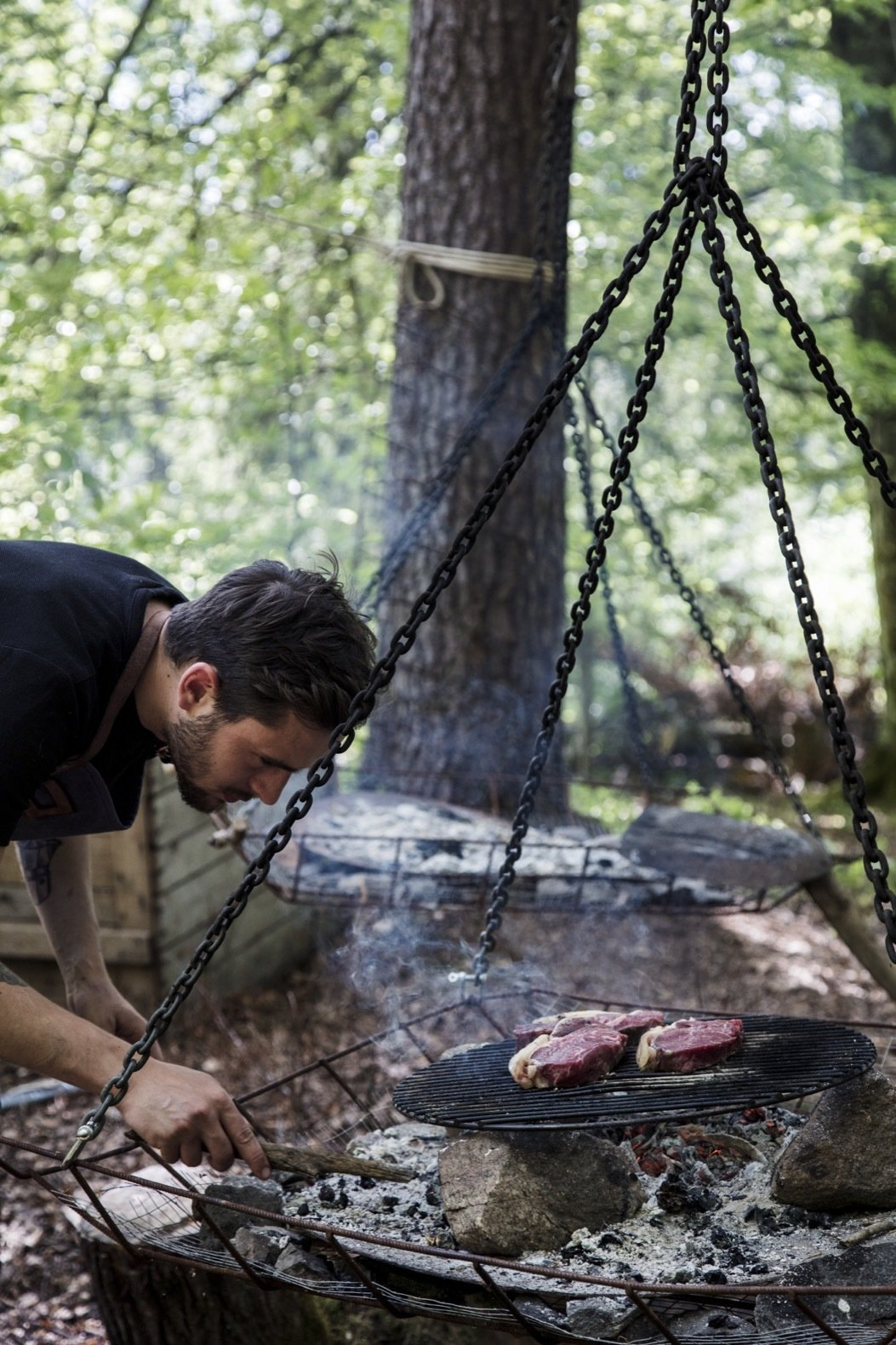 Outdoor Stedsans in the Woods also offers a more DIY approach to dinner on weekdays, when guests are taught how to cook their meal over an open fire.    Photo 10 of 18 in This Swedish Permaculture Retreat Is a Foodie's Paradise