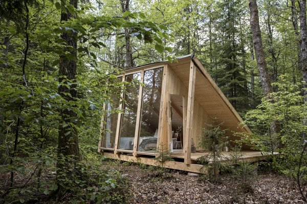 """""""My dogma is inspired by a Japanese saying that an object gets its energy from three different elements: the material it is made out of, the person who made it, and the people who cared for it,"""" says Mette. The cabins have been built of wood carried through the forest."""