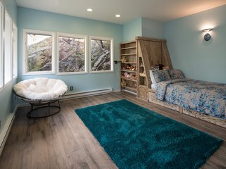 The northeast bedroom is built into Gyp Rock and comes with a handmade, white-oak built-in bed, as well as a private entrance to a small deck.