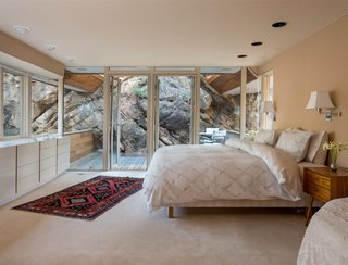 Gyp Rock is a standout feature in the upper-level master bedroom, which connects to a deck built on the moss rock.