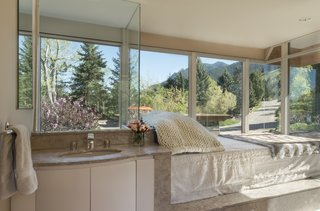 The master bathroom offers unobstructed views of the Flatirons.