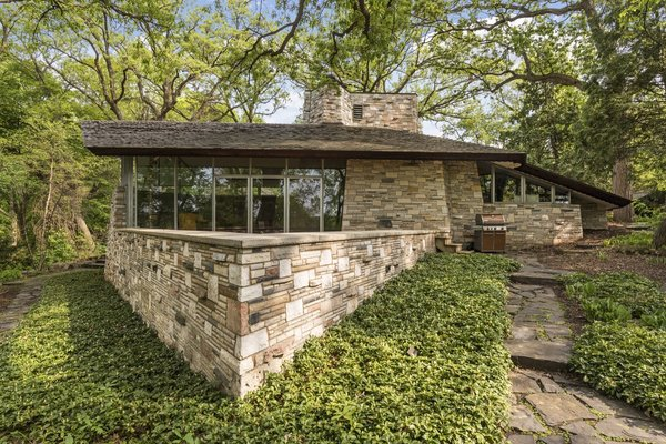 This stunning property features unique marble masonry—an element not found in any other Frank Lloyd Wright home.
