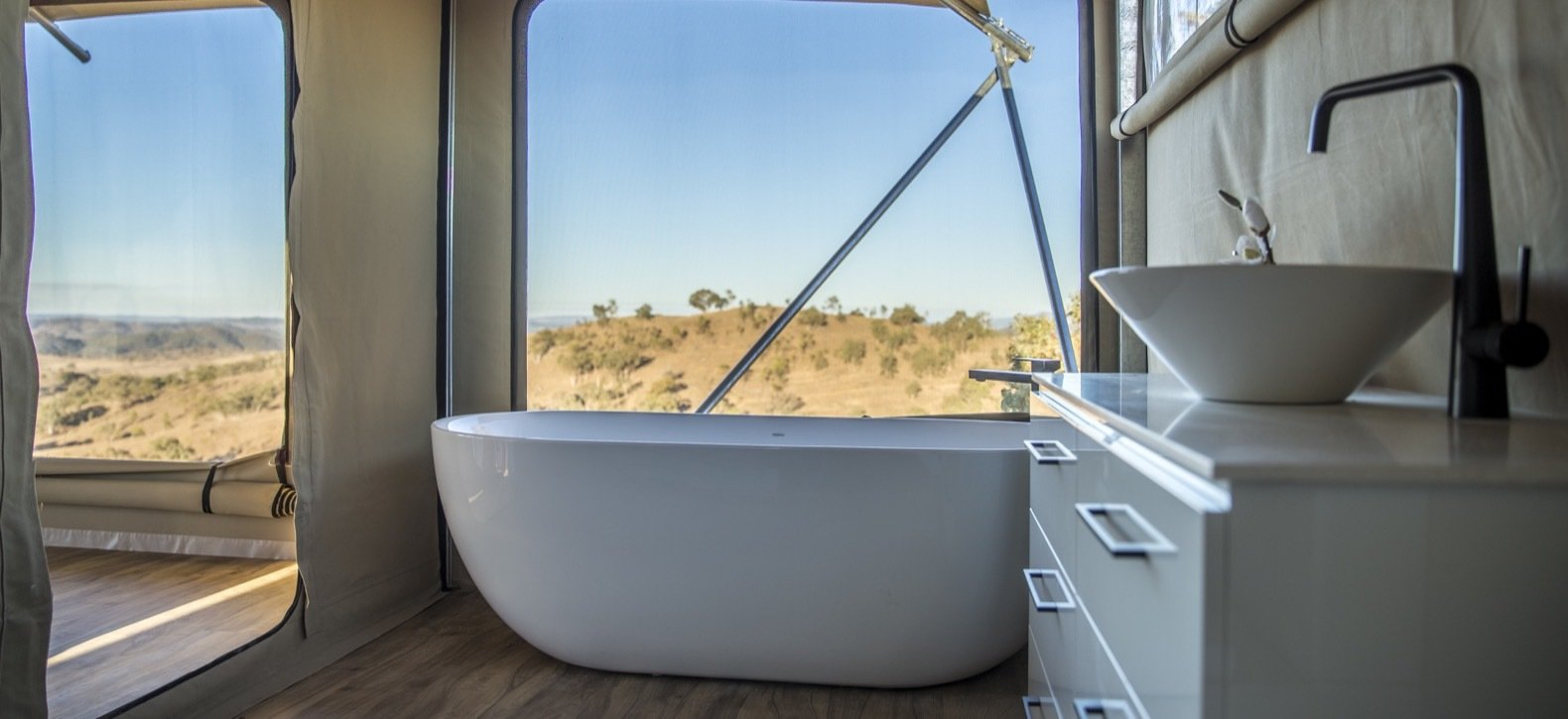 Bath Room, Freestanding Tub, Medium Hardwood Floor, and Vessel Sink The interior freestanding bath in the Uralla.  Photo 10 of 11 in Escape to the Australian Bush in Style With These Eco-Friendly, Luxe Tents
