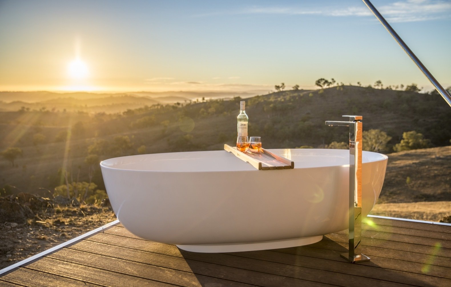 Bath Room, Freestanding Tub, and Medium Hardwood Floor Crafted for honeymooners, the Uralla tent boasts the amenities of the Dulili in addition to an outdoor freestanding bathtub, prime hilltop views, and complimentary champagne and treats.   Photo 11 of 11 in Escape to the Australian Bush in Style With These Eco-Friendly, Luxe Tents