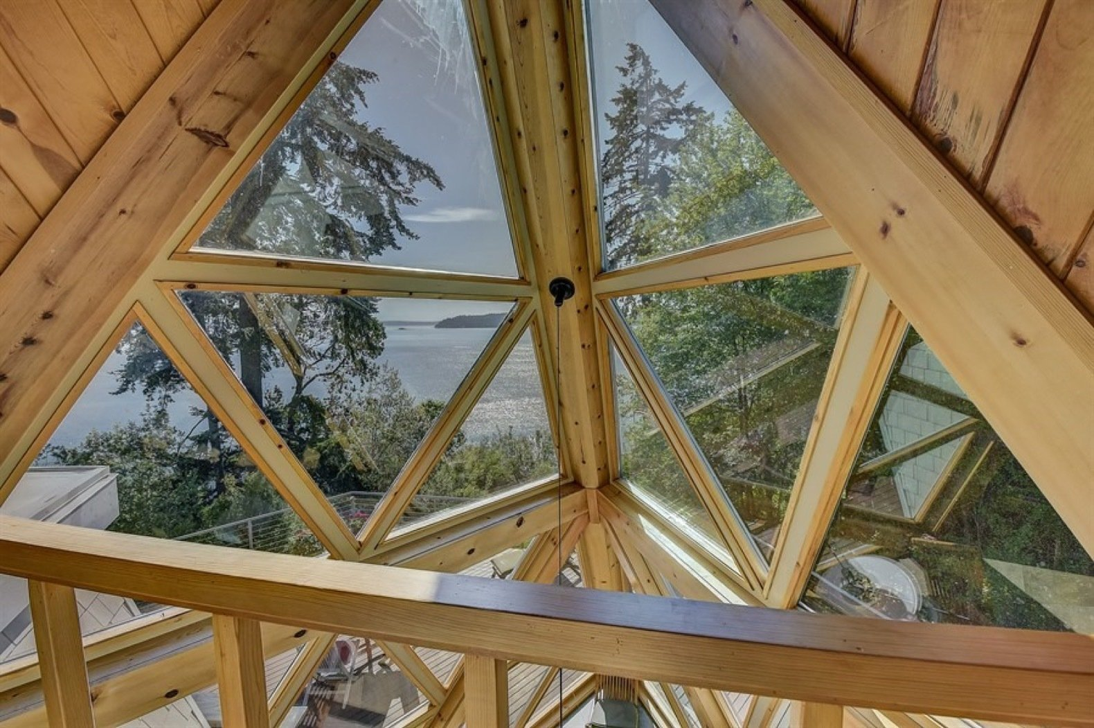 Windows, Wood, and Skylight Window Type The cabin's original architecture and expansion were carefully designed to capture panoramic views from every room.    Photo 9 of 11 in A Tetrahedron Cabin With Stellar Seaside Views Is Listed For $695K