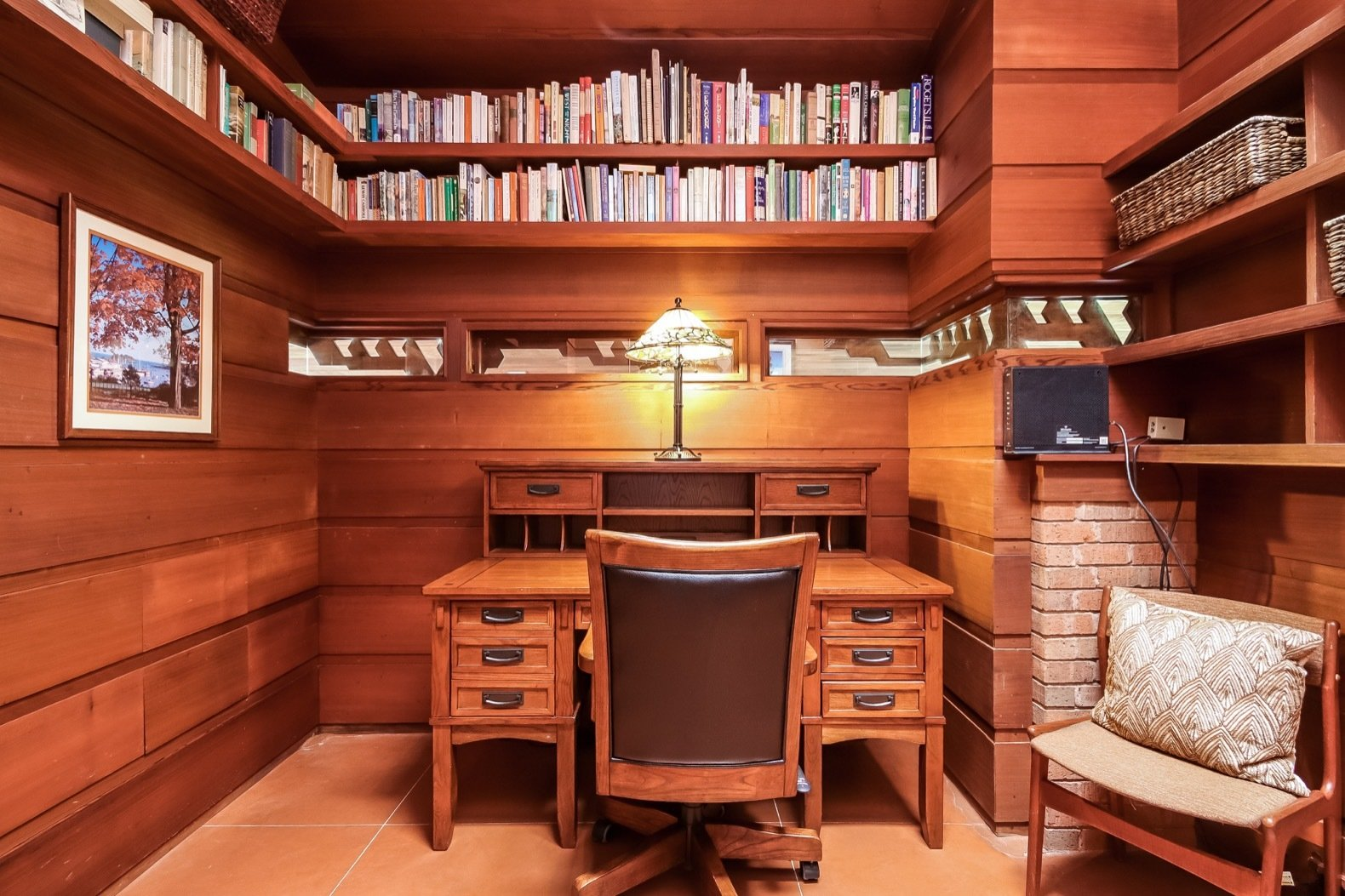 Office, Chair, Shelves, Concrete Floor, Desk, and Study Room Type Built-in shelving wraps around the workspace, located next to the second bedroom.   Photo 15 of 17 in A Gorgeous Frank Lloyd Wright Home Hits the Market For the First Time at $1.2M