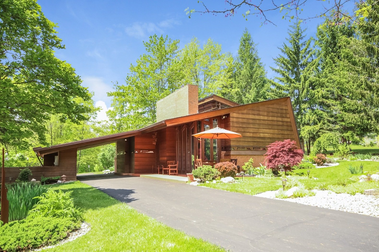 Exterior, House Building Type, Shed RoofLine, Wood Siding Material, Brick Siding Material, Mid-Century Building Type, and Shingles Roof Material The Whiteford-Haddock home is on the market for $1.2M in Ann Arbor, MI.  Photo 17 of 17 in A Gorgeous Frank Lloyd Wright Home Hits the Market For the First Time at $1.2M