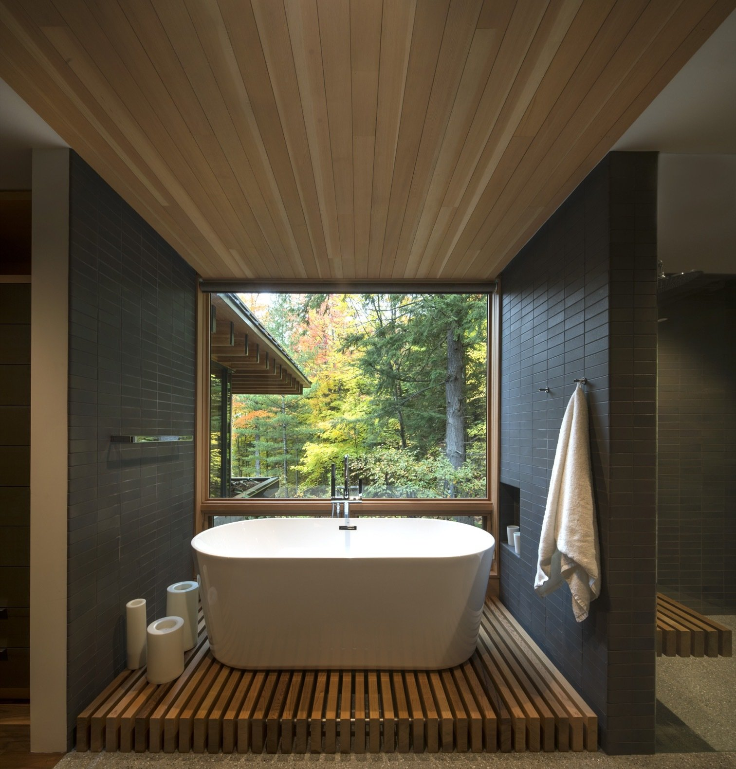 Bath Room, Freestanding Tub, Terrazzo Floor, and Soaking Tub The master suite opens to a bathroom with soaking tubs that overlook south-facing views.    Photo 13 of 16 in This Award-Winning Cabin Is a Relaxing Antidote to City Living