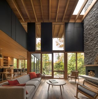 Sited in a remote Canadian forest, this luxurious cabin rental embraces indoor/outdoor living.
