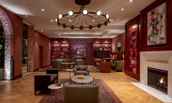 The Press Room lounge is peppered with references to the building's ties to The Daily Picayune newspaper. The cranberry-colored room is anchored by a marble fireplace and a large custom brass light fixture.