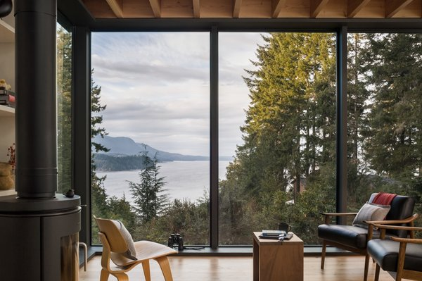 Full-height windows blur the distinction between indoor and outdoors in the living area.