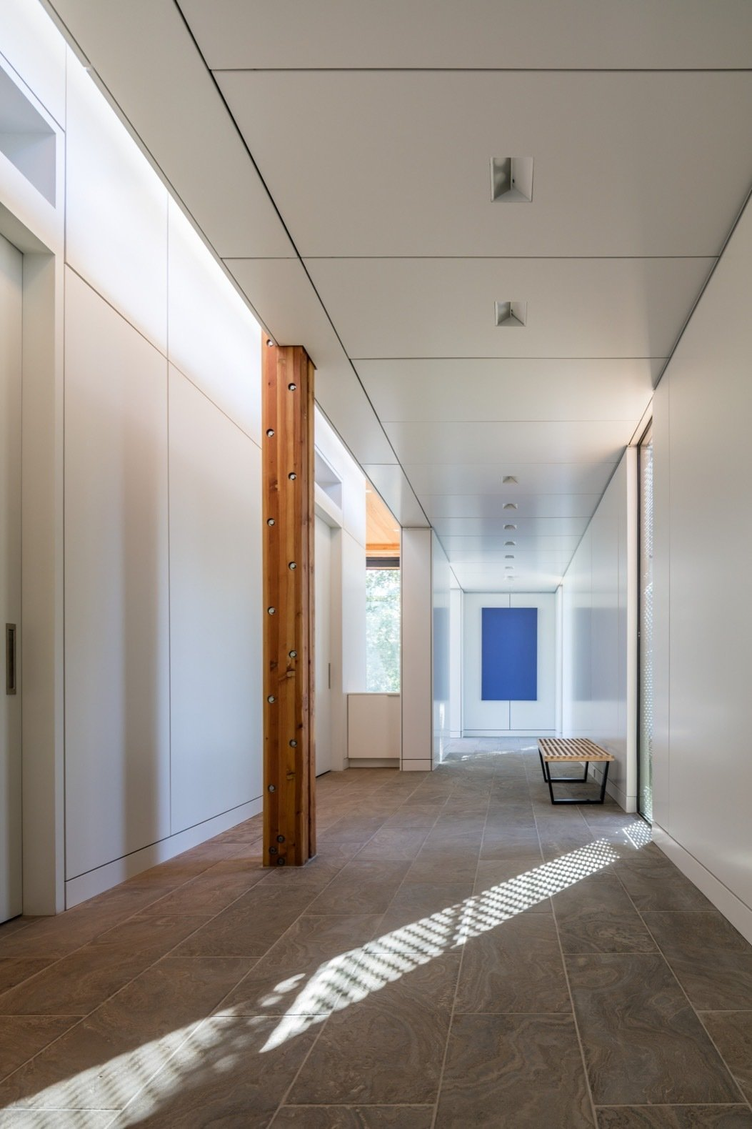 Hallway and Slate Floor The buildings were constructed with glulam columns and beams.   Photo 9 of 14 in This Elegant Californian Prefab Minimizes Site Disturbance