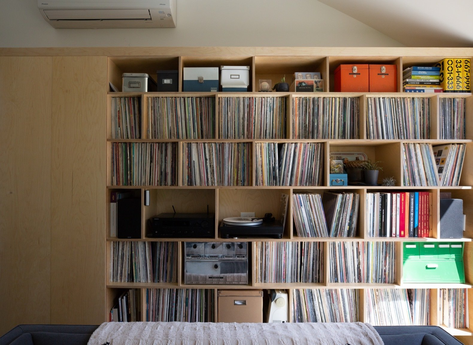 Storage Room and Shelves Storage Type Scott's extensive record collection occupies a large portion of the living room wall.  Photo 10 of 20 in Budget Breakdown: A Portland Couple Design and Build a Compact Home For $222K
