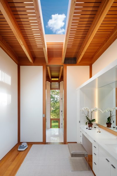 A large skylight lets ample light into the bathroom.