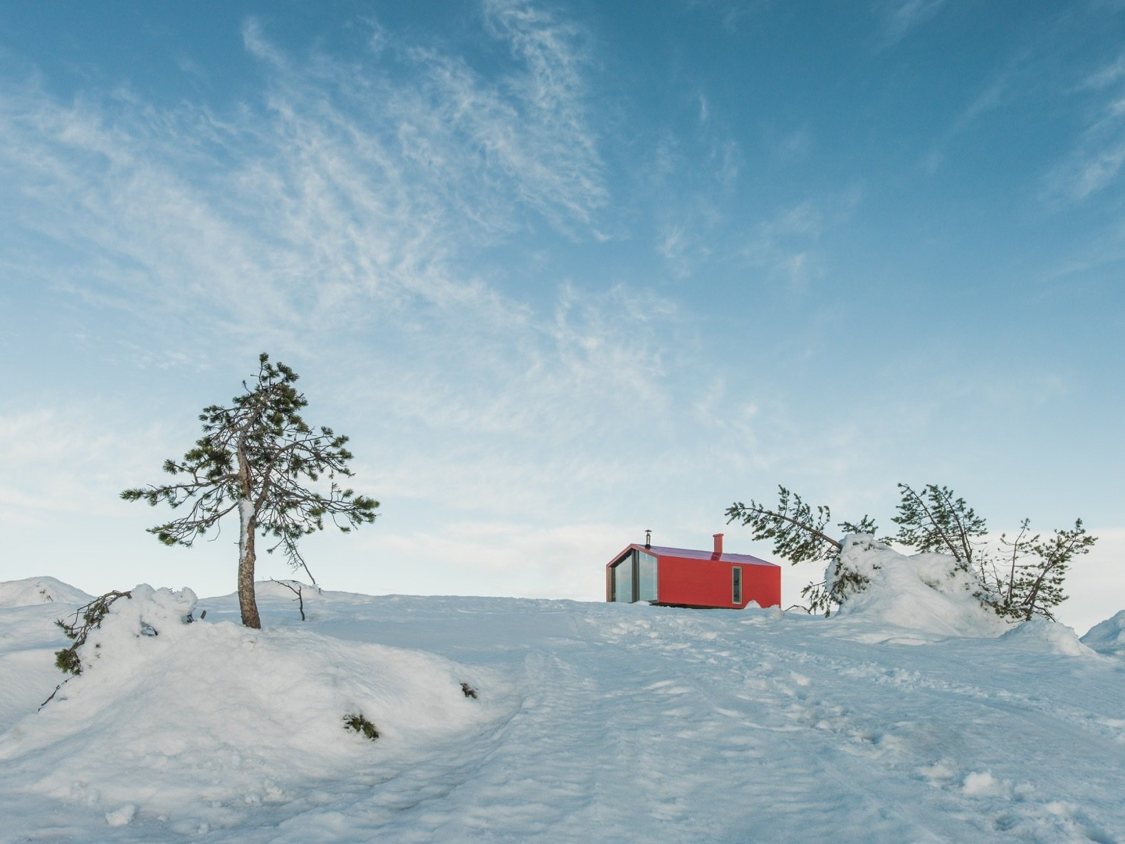 Exterior, Metal Siding Material, Gable RoofLine, Metal Roof Material, Prefab Building Type, Cabin Building Type, and Small Home Building Type The prefab cabin is a 40-minute hike from Kandalaksha.  Photo 7 of 22 in Go Off-Grid in Russia With This Bright Red Prefab Cabin