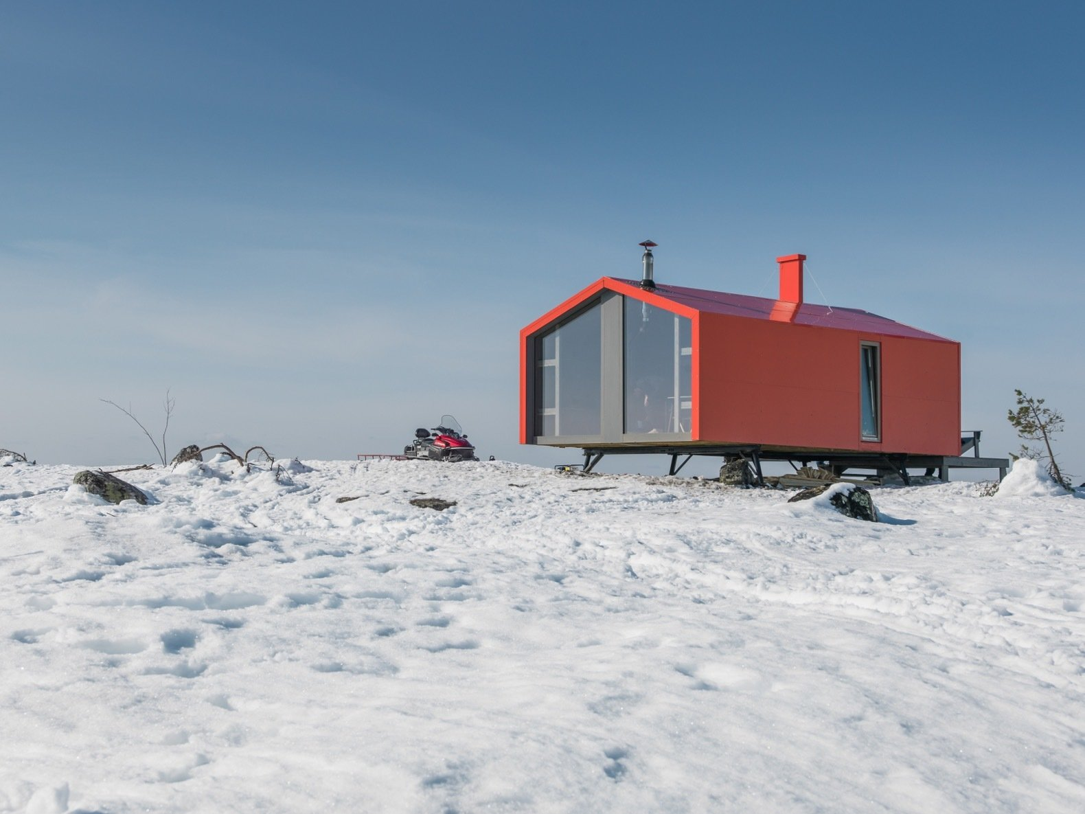 Exterior, Metal Siding Material, Metal Roof Material, Prefab Building Type, Cabin Building Type, Gable RoofLine, and Small Home Building Type The prefab cabin is elevated atop six metal pillars to minimize site impact.   Photo 8 of 22 in Go Off-Grid in Russia With This Bright Red Prefab Cabin