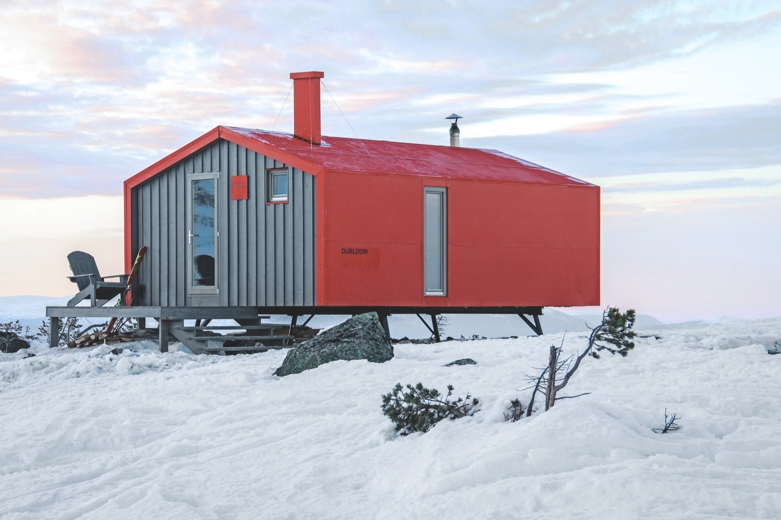 Exterior, Metal Roof Material, Cabin Building Type, Prefab Building Type, Metal Siding Material, Gable RoofLine, and Small Home Building Type The north-end of the cabin features an outdoor deck.    Photo 9 of 22 in Go Off-Grid in Russia With This Bright Red Prefab Cabin