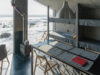 """""""A minimalistic color spectrum was used in order not to distract from the main accent—the view from the window,"""" adds the architects."""