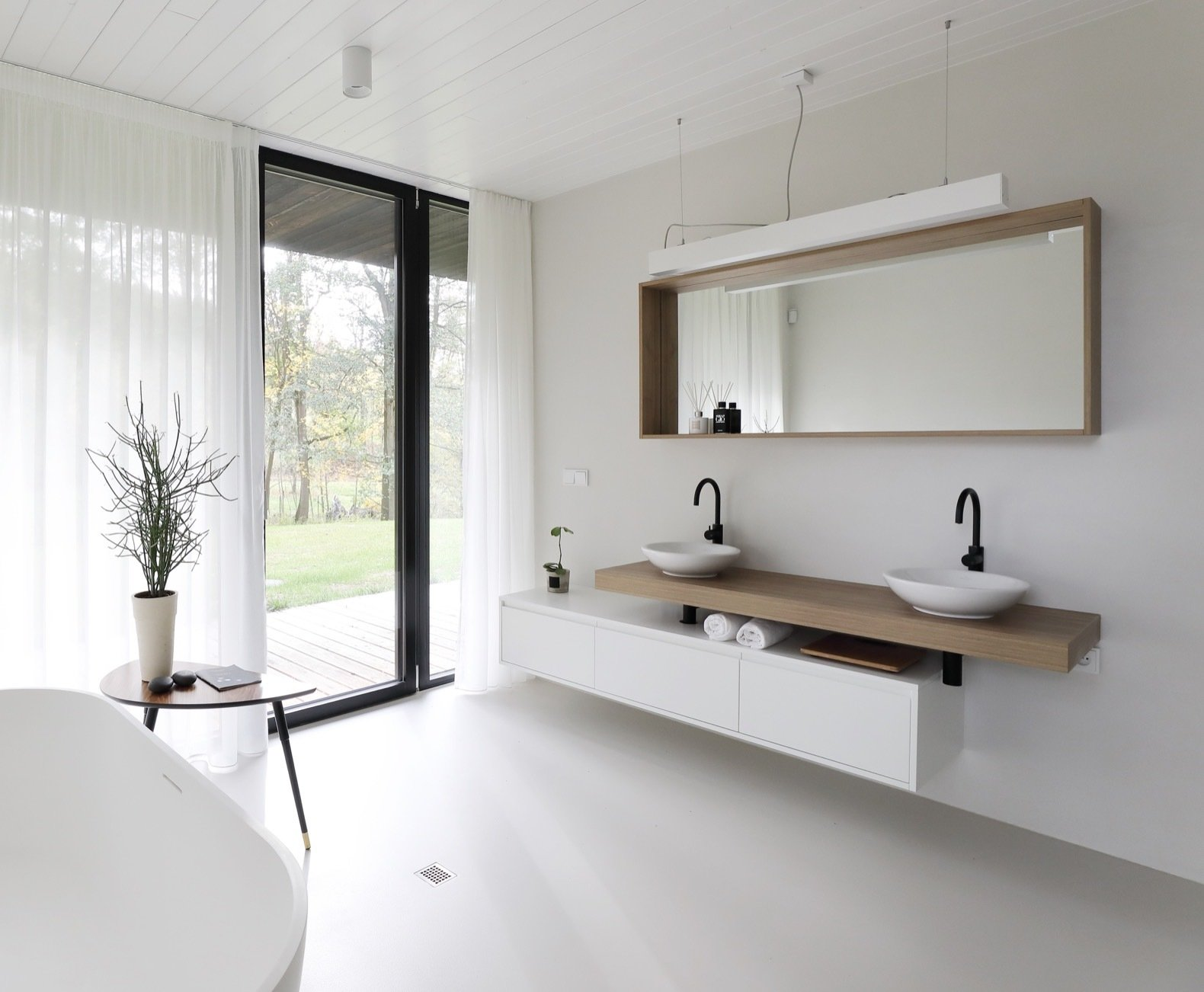 Bath, Concrete, Vessel, Wood, Freestanding, Pendant, and Ceiling Even the bathroom offers access to the outdoors.   Bath Wood Freestanding Pendant Photos from This Minimalist Bungalow Will Change Color Over Time