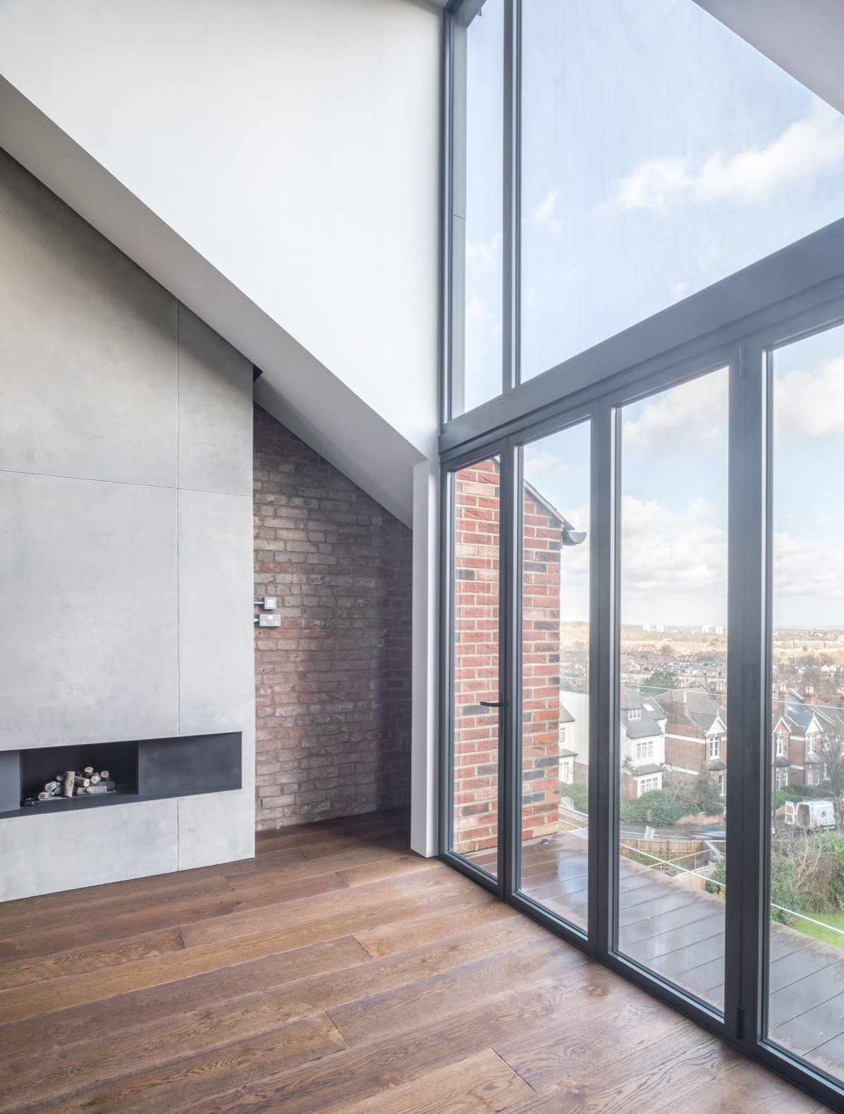 Windows, Sliding, and Metal The architects installed Luxal aluminum glazing, which allows the interior space to be flooded with natural light. In addition, the floor-to-ceiling windows are perfectly positioned to frame the breathtaking views over North London and Alexandra Palace.    Best Windows Sliding Metal Photos from A Shabby Attic Becomes a Chic, Cathedral-Style Living Space