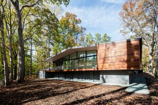 The steel-framed glazed living pavilion is partly clad in wood and sits atop CMU walls.