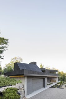 Photovoltaic panels have been installed on the sloped, south-facing volume.