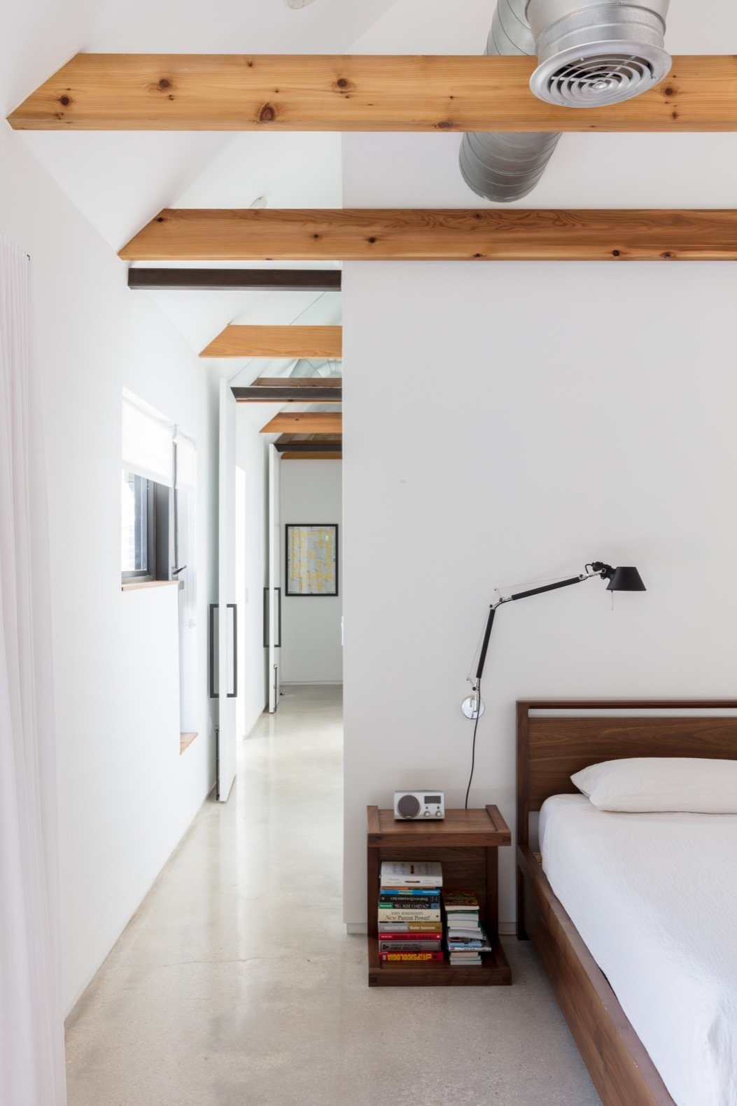 Bedroom, Wall, Bed, Concrete, and Night Stands The new addition features polished concrete floors throughout.   Best Bedroom Bed Concrete Wall Night Stands Photos from A Minimalist Bungalow in Miami Welcomes a Sleek New Addition