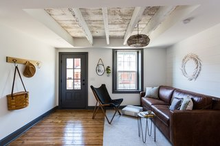To give the interior a more open and spacious feel, the team exposed the ceiling beams.