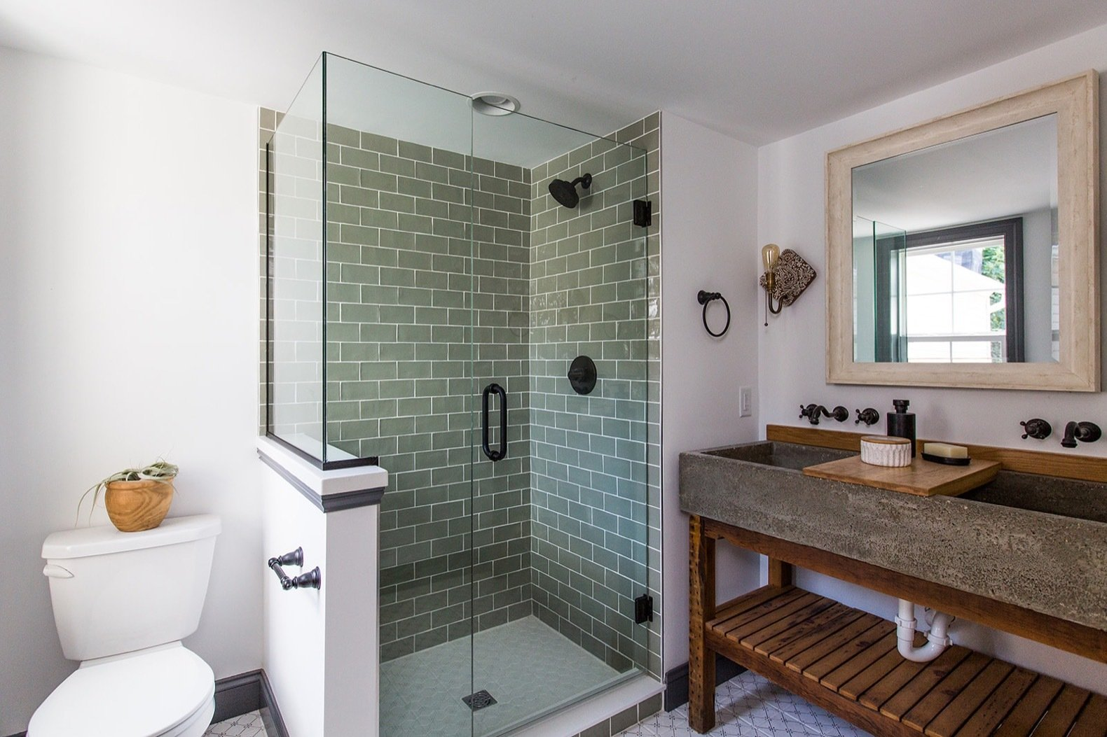 Bath, Two Piece, Ceramic Tile, Wood, Recessed, Wall, Vessel, Enclosed, and Wall Mount Sage-colored clay tiles line the shower stall in the master bath.     Best Bath Enclosed Wall Wall Mount Recessed Photos from Before & After: A Dark 1880s Row Home Gets an Airy Makeover