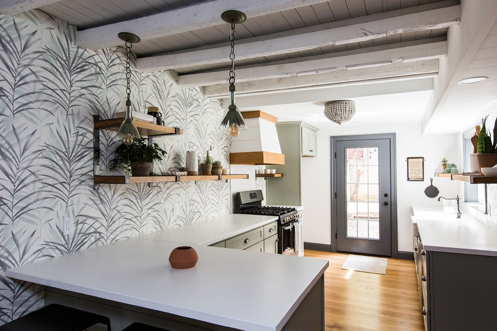 Kitchen, Concrete, Range, Medium Hardwood, Wood, Brick, Pendant, Ceiling, Colorful, Vessel, and Range Hood To create more natural light, Brentwood Builders also added a back door to the kitchen.    Best Kitchen Wood Brick Photos from Before & After: A Dark 1880s Row Home Gets an Airy Makeover