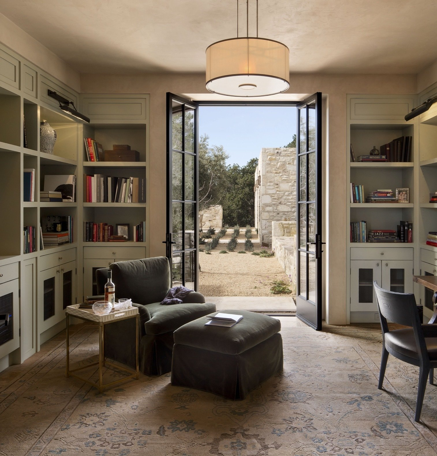 Office, Rug, Shelves, Light Hardwood, Chair, and Library The library overlooks the courtyard and the two guest bedrooms.   Best Office Library Shelves Photos from Glass and Stone Combine to Dazzling Effect on California's Central Coast