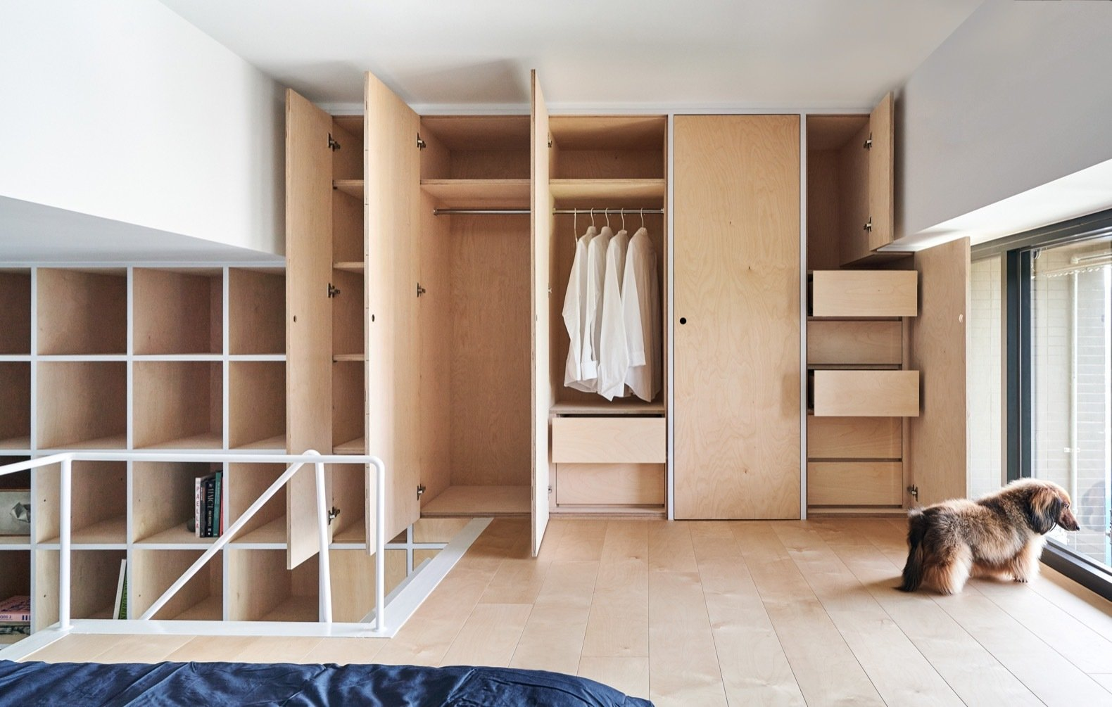 Storage Room, Closet Storage Type, and Shelves Storage Type The minimalist built-in storage units draw inspiration from the Japanese brand MUJI.    Photo 16 of 17 in A Tiny Taipei Apartment Pursues Muji-Like Minimalism For $35K