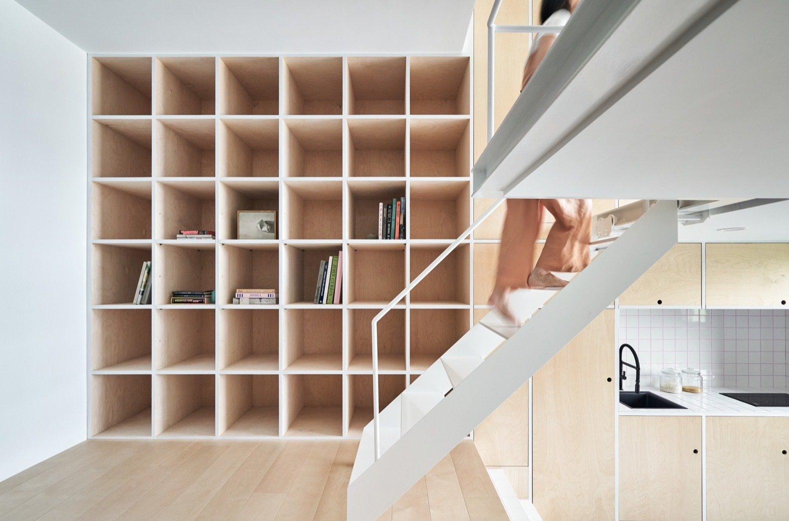Storage and Shelves Storage takes up an entire wall in the dwelling.  Best Storage Shelves Photos from A Tiny Taipei Apartment Pursues Muji-Like Minimalism For $35K