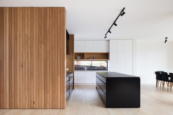 "With the help of local design practice Modscape, a family in Melbourne gained a new energy-efficient addition that not only transformed their home life for the better, but also allowed them to live ""disruption-free"" during the construction process. As the heart of the home, the centrally placed kitchen offers an abundance of storage with the addition of a butler's pantry."